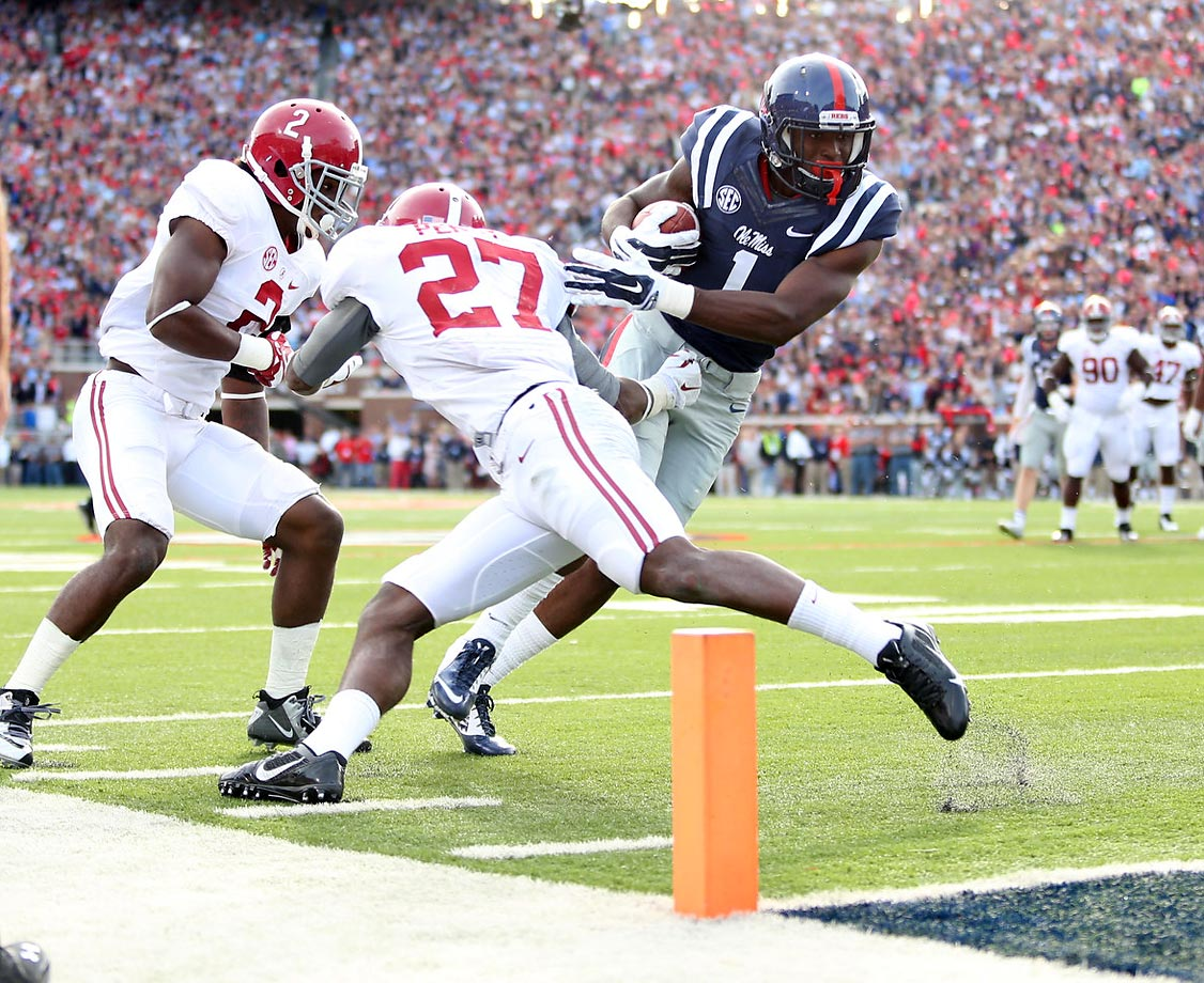 Ole Miss wide receiver Laquon Treadwell dodges Alabama defensive backs Nick Perry and Tony Brown to score.