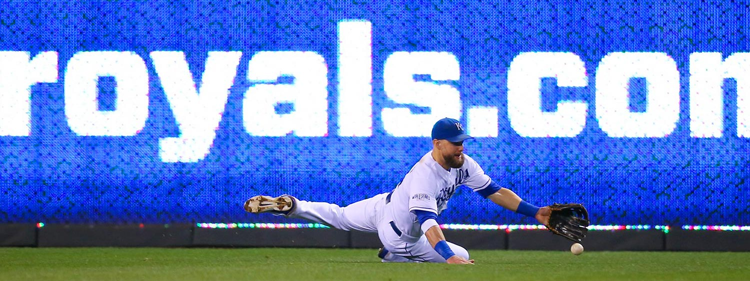 Kansas City Royals left fielder Alex Gordon reaches for the ball in Game 1 of the World Series against the San Francisco Giants.