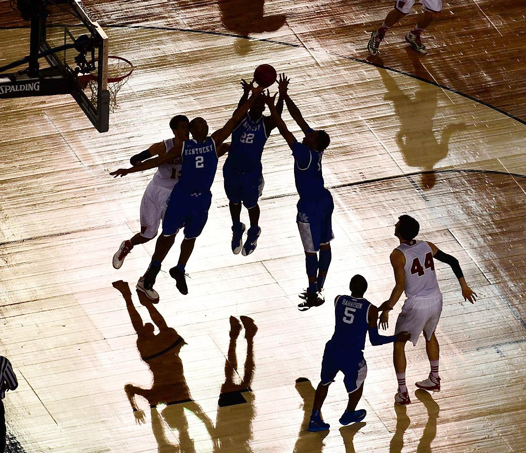 Alex Poythress and teammates go up for a rebound against Wisconsin in the 2014 Final Four.
