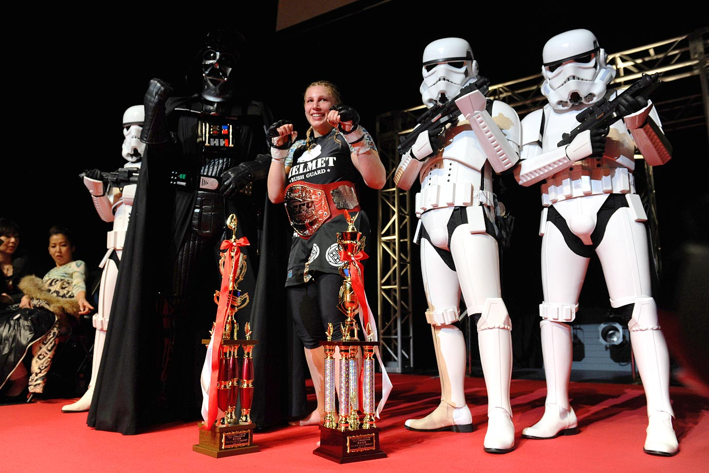 MMA fighter Amanda Lucas, daughter of Star Wars visionary George Lucas, poses with Darth Vader and several stormtroopers after earning her first MMA championship on Feb. 18, 2012 at Deep 57 in Japan.