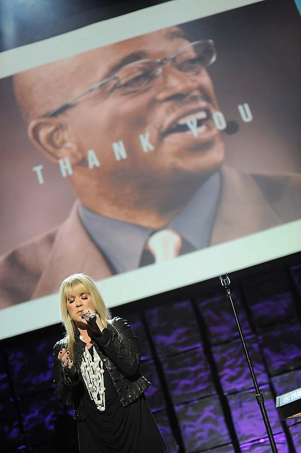 Natalie Grant performs onstage with an image of late ESPN announcer Stuart Scott in the background during the 16th Annual Super Bowl Gospel Celebration at Arizona State on Friday.