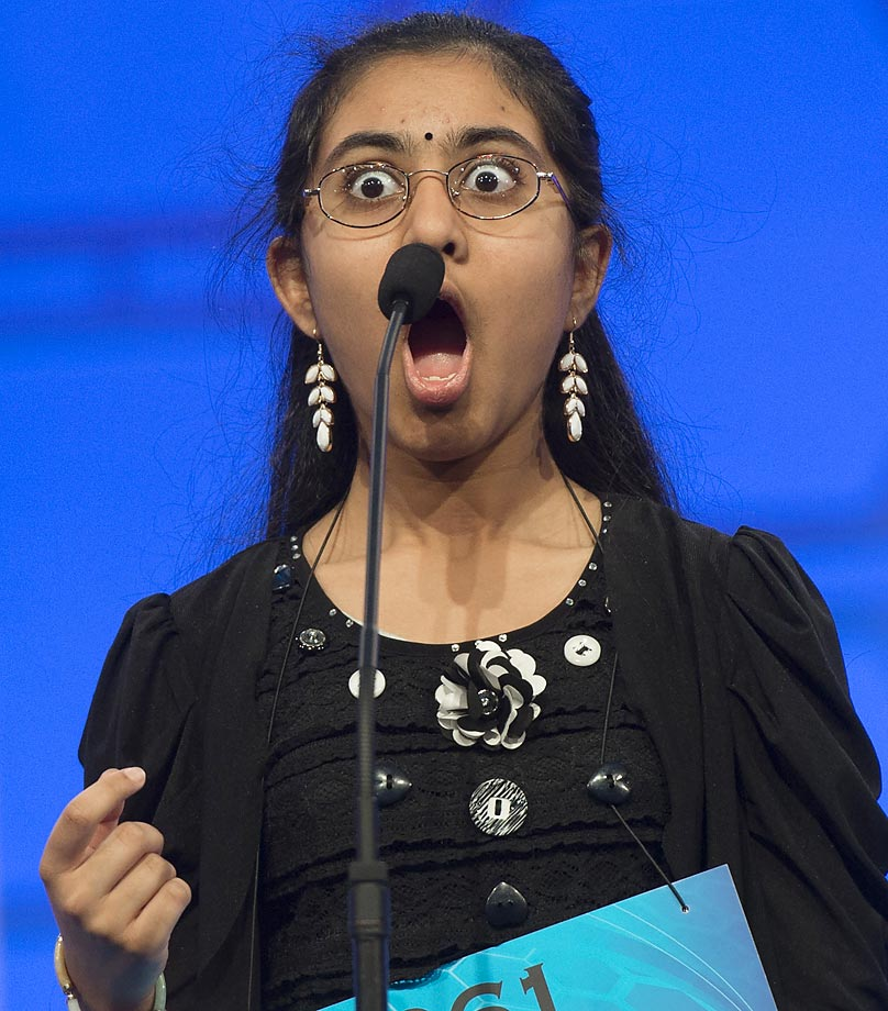 Ankita Vadiala of Manassas, Va., reacts to hearing her word during the semifinal round of the 88th Annual Scripps National Spelling Bee.