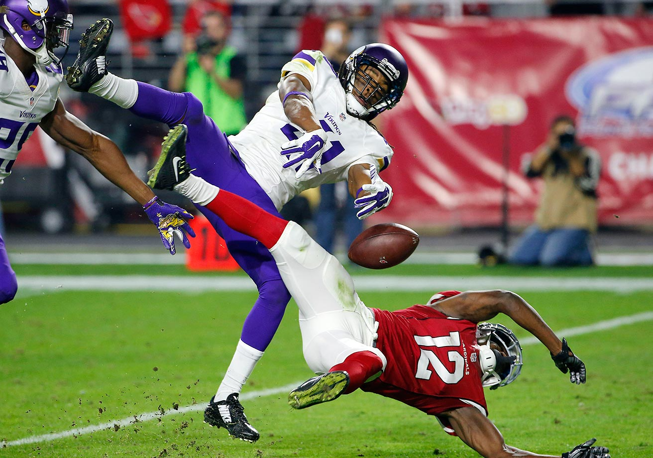 Anthony Harris of the Vikings breaks up a pass intended for John Brown of the Cardinals.