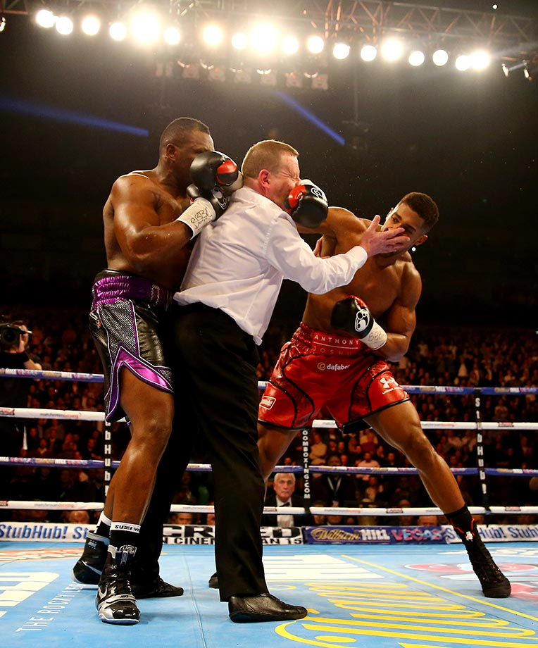 Anthony Joshua throws a punch after the bell against Dillian Whyte.
