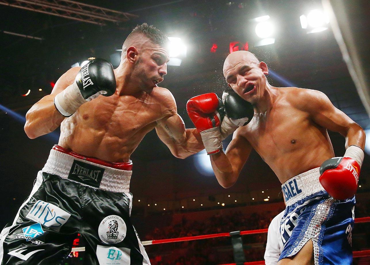 Leonardo Zappavigna of Australia punches Michael Castillo of Mexico during the WBC Silver Light Middleweight fight.