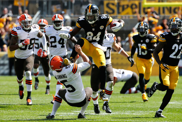 Antonio Brown and Spencer Lanning :: AP
