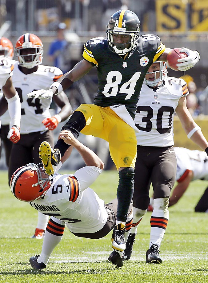 Antonio Brown of the Pittsburgh Steelers kicks Cleveland Browns punter Spencer Lanning as he jumps while returning a pun. Brown was penalized for unnecessary roughness.