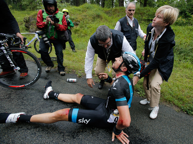 Medics tend to Spain's Xabier Zandio after he crashed during the sixth stage of the Tour de France cycling race over 194 kilometers (120.5 miles) with start in Arras and finish in Reims, France, Thursday, July 10, 2014. Zandio is the second team Sky rider to abandon the race after Britain's Christopher Froome crashed and abandoned yesterday.
