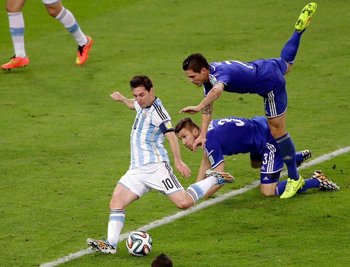 Lionel Messi evades multiple Bosnia-Herzegovina defenders en route to scoring the game-winning goal in Argentina's opening match of group play.