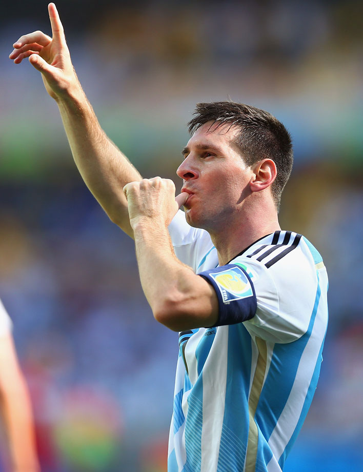 Lionel Messi celebrates after his stoppage-time goal against Iran snapped a 1-0 deadlock and gave Argentina another three-point haul.