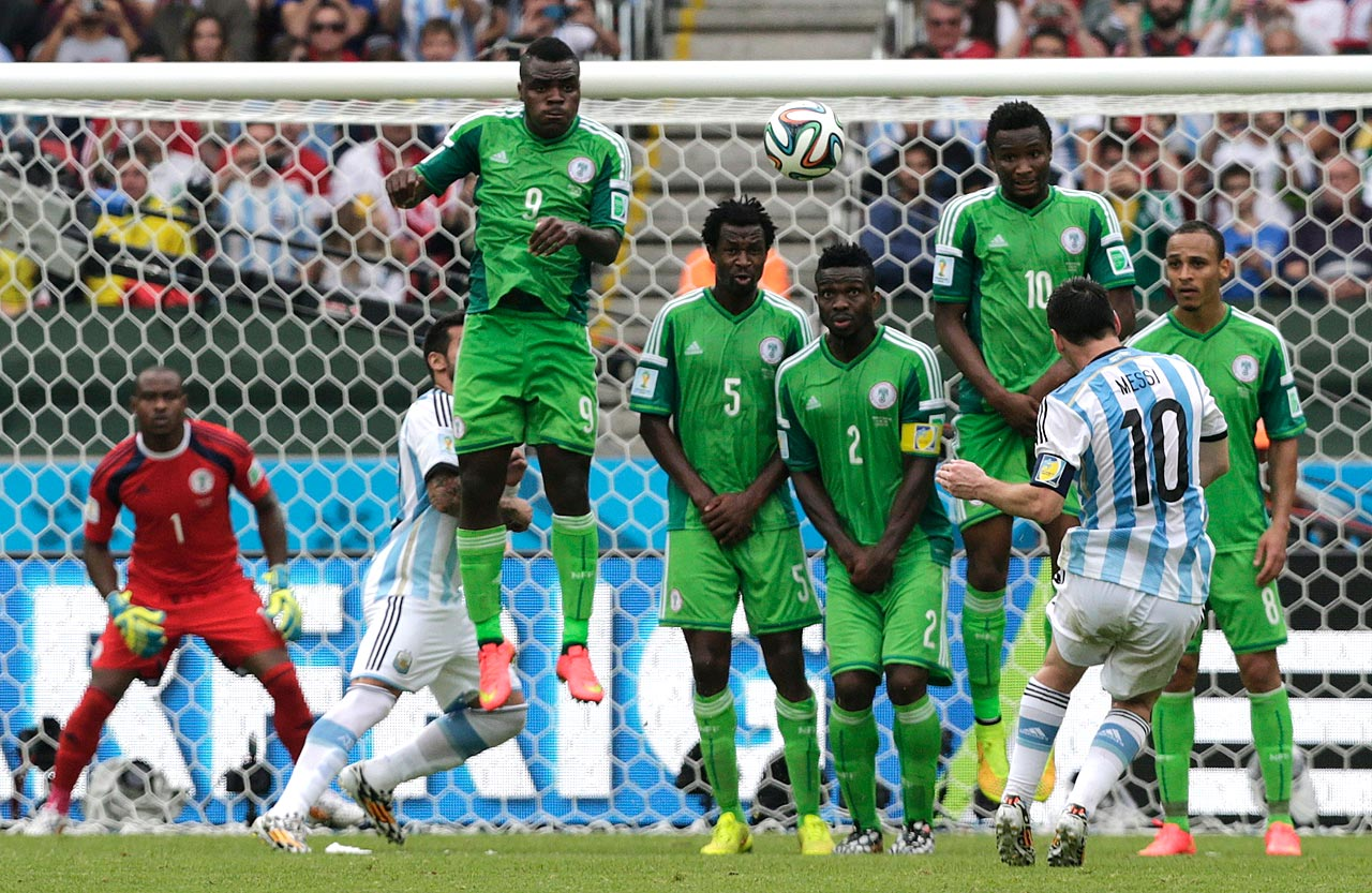Lionel Messi bends his free kick up and over Nigeria's wall as part of a two-goal showing in Argentina's 3-2 win to secure first place in Group F.