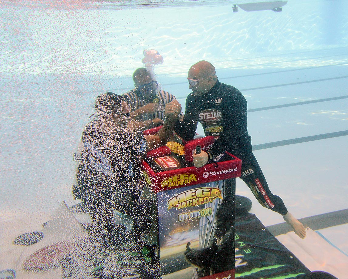 Multiple arm wrestling world champion Ion Oncescu (right) arm wrestles underwater in Bucharest 2012.