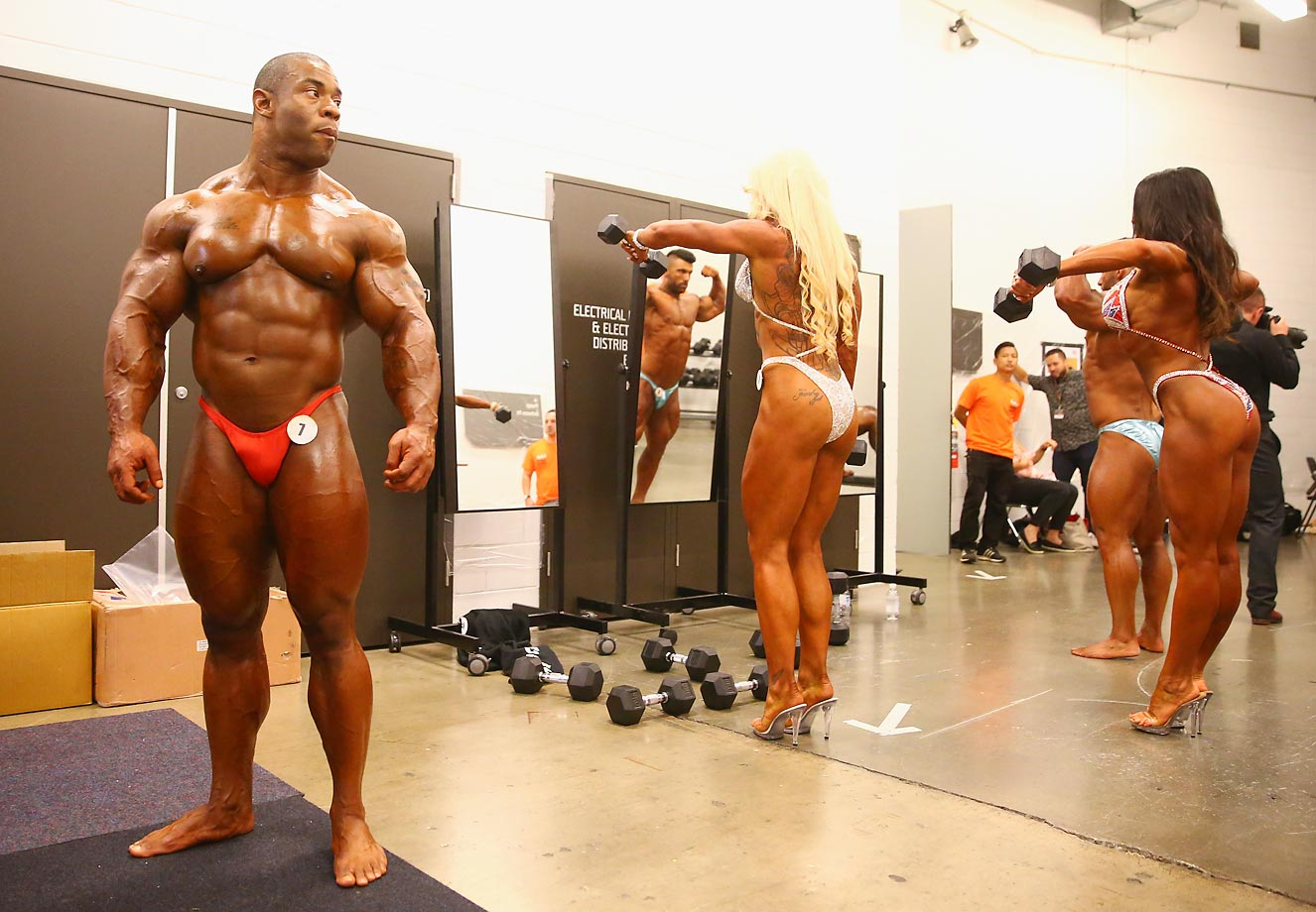 Competitors prepare backstage for the Arnold Classic.