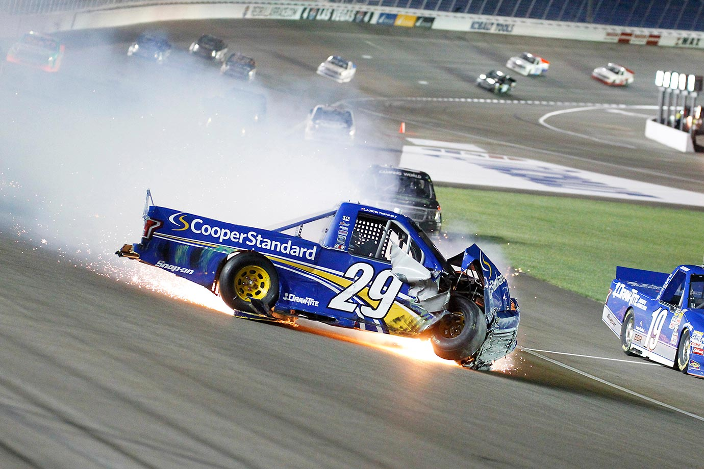 Austin Theriault slides through the tri-oval after contact from teammate Tyler Reddick.