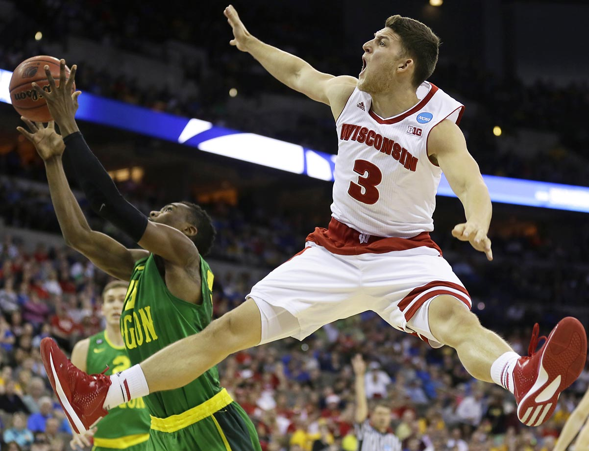 Zak Showalter of Wisconsin fights for a rebound against Oregon guard Jalil Abdul-Bassit. Abdul-Bassit was called for a foul on the play.