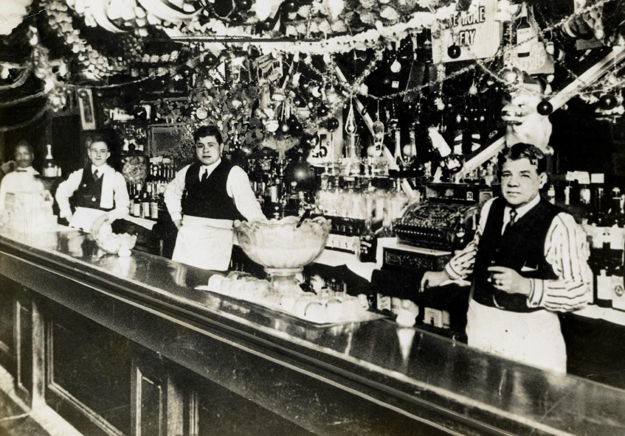 Babe Ruth (center) with his father, George Herman Ruth Sr, tend bar in Baltimore in 1915. The elder Ruth owned several saloons in the Baltimore area.