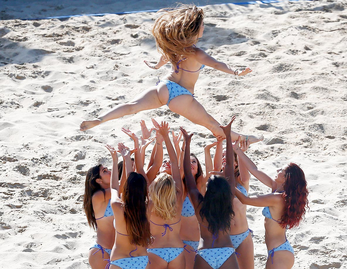 The Beach Babes perform at the Beach Soccer World Cup match between Brazil and Mexico in Portugal.