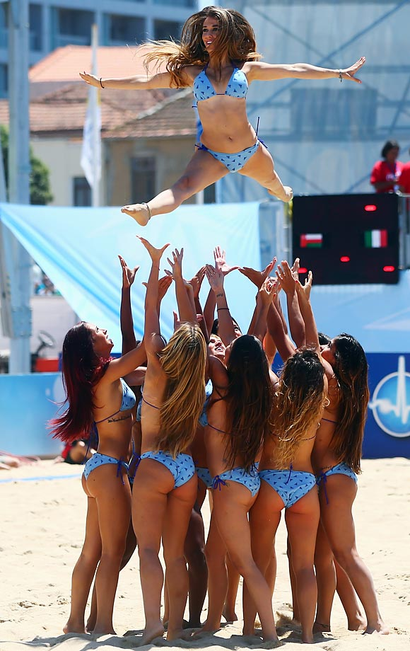 "According to BeachSoccer-Online.com, ""one of the highlights of a beach soccer event (apart from the soccer action, of course), is the entertainment provided during the intervals and between the matches.""  The Beach Babes didn't disappoint during a July 10 World Cup meeting between Spain and Iran in Espinho, Portugal."