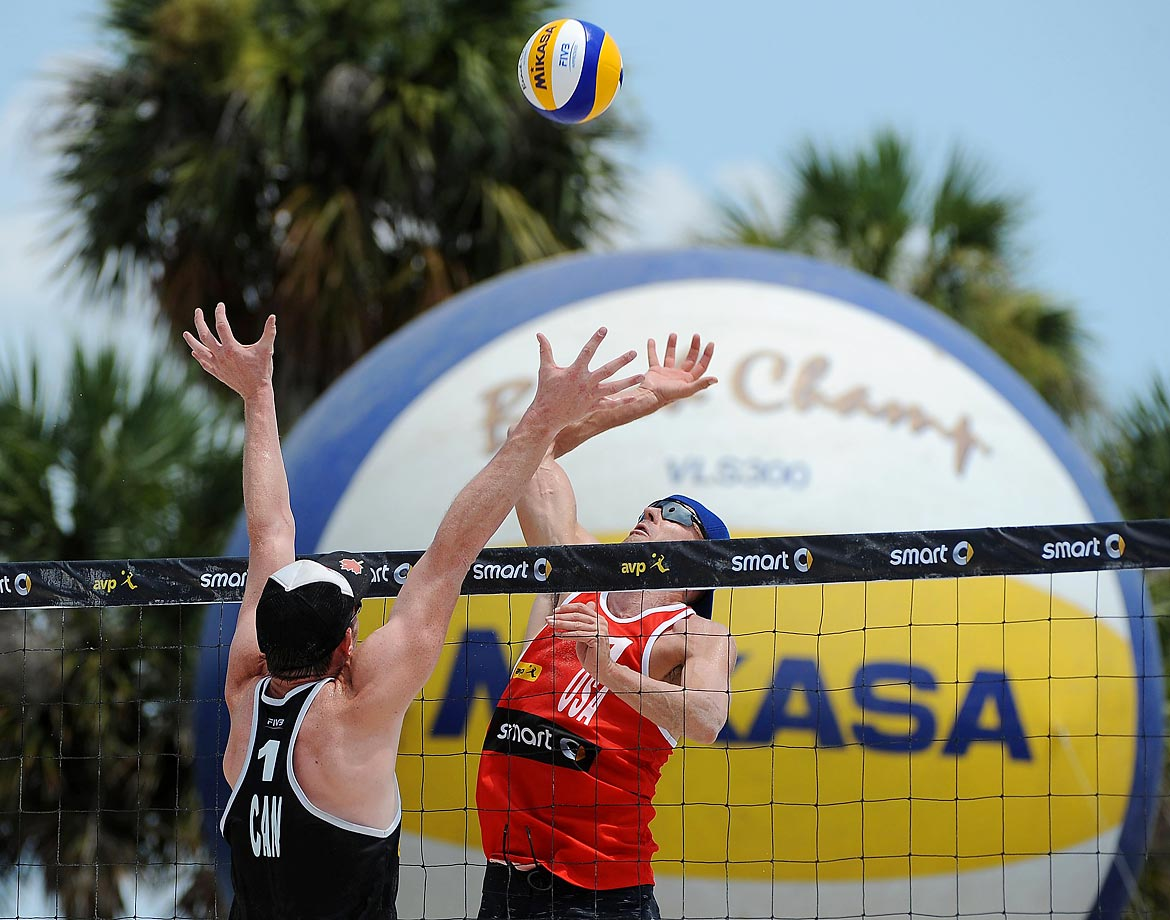Jacob Gibb of the U.S. goes up for a spike against Josh Binstock of Canada.