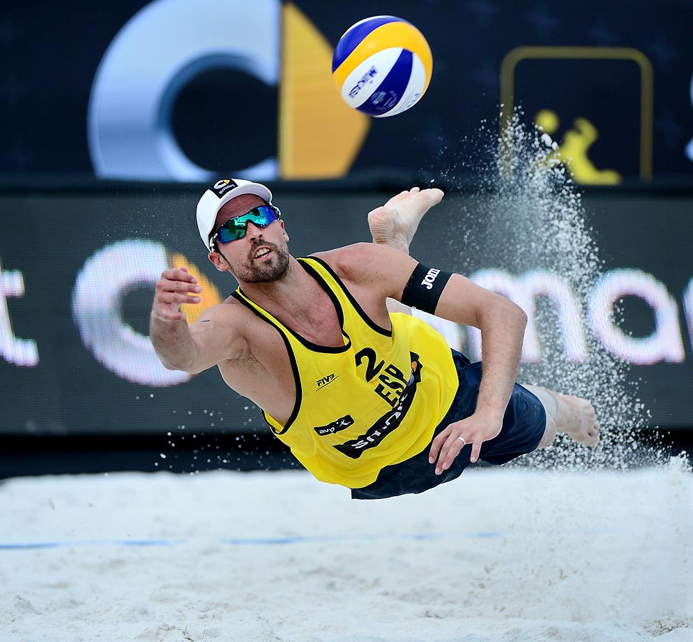 Adrian Gavira of Spain dives and digs the ball against a team from the U.S.