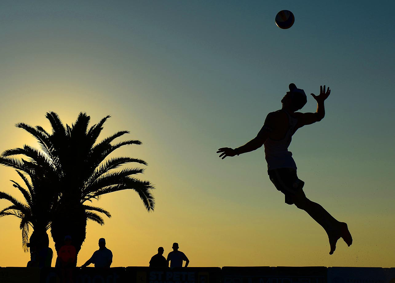 Clemens Doppler of Austria serves the ball against Paolo Nicolai and Daniele Lupo of Italy.