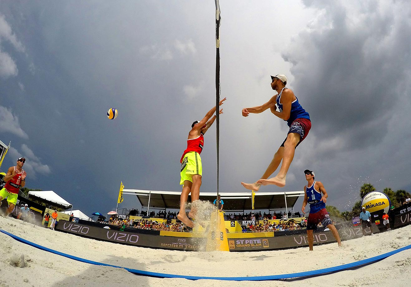 Theodore Brunner of the U.S. spikes the ball as teammate Nick Lucena looks on against Clemens Doppler and Alexander Horst of Austria during the bronze medal match.
