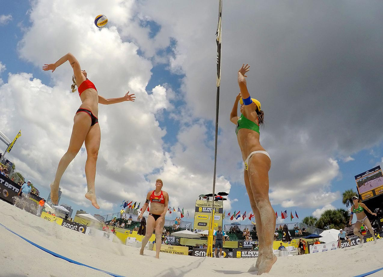 Britta Buthe of Germany spikes the ball against Juliana Felisberta of Brazil in the semifinals.