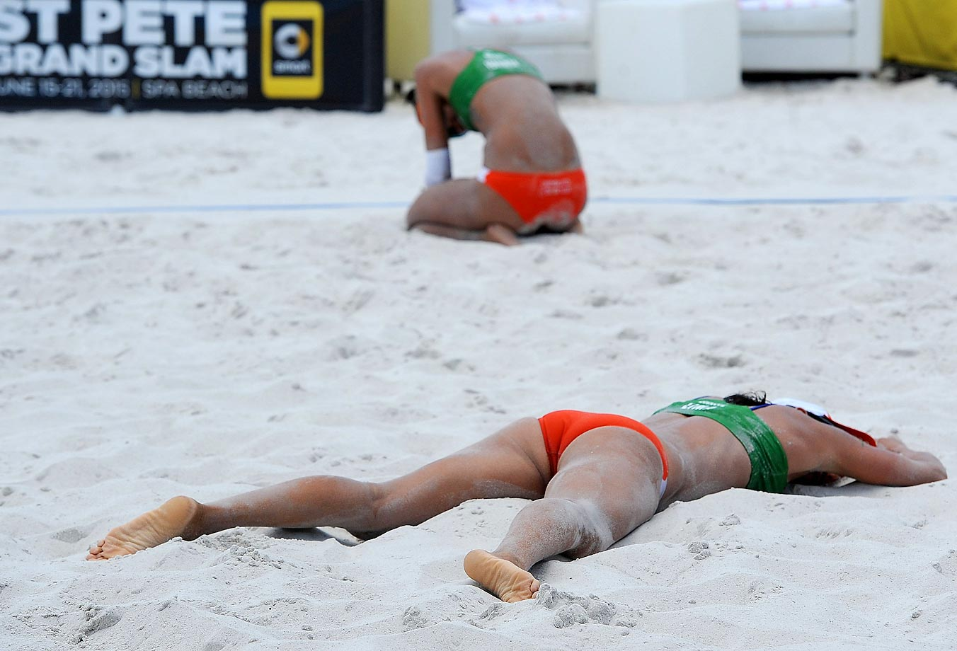 Fernanda Alves Berti and Taiana Lima of Brazil collapse after the final point of the bronze medal game, which they won.