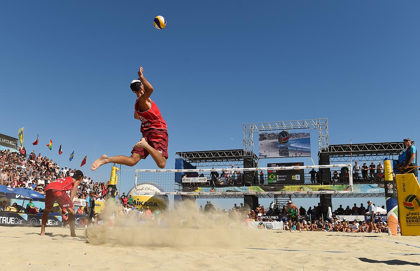 "Phil Dalhausser is already pretty darn tall (6'9"") and looks twice that as he jump serves in the final."