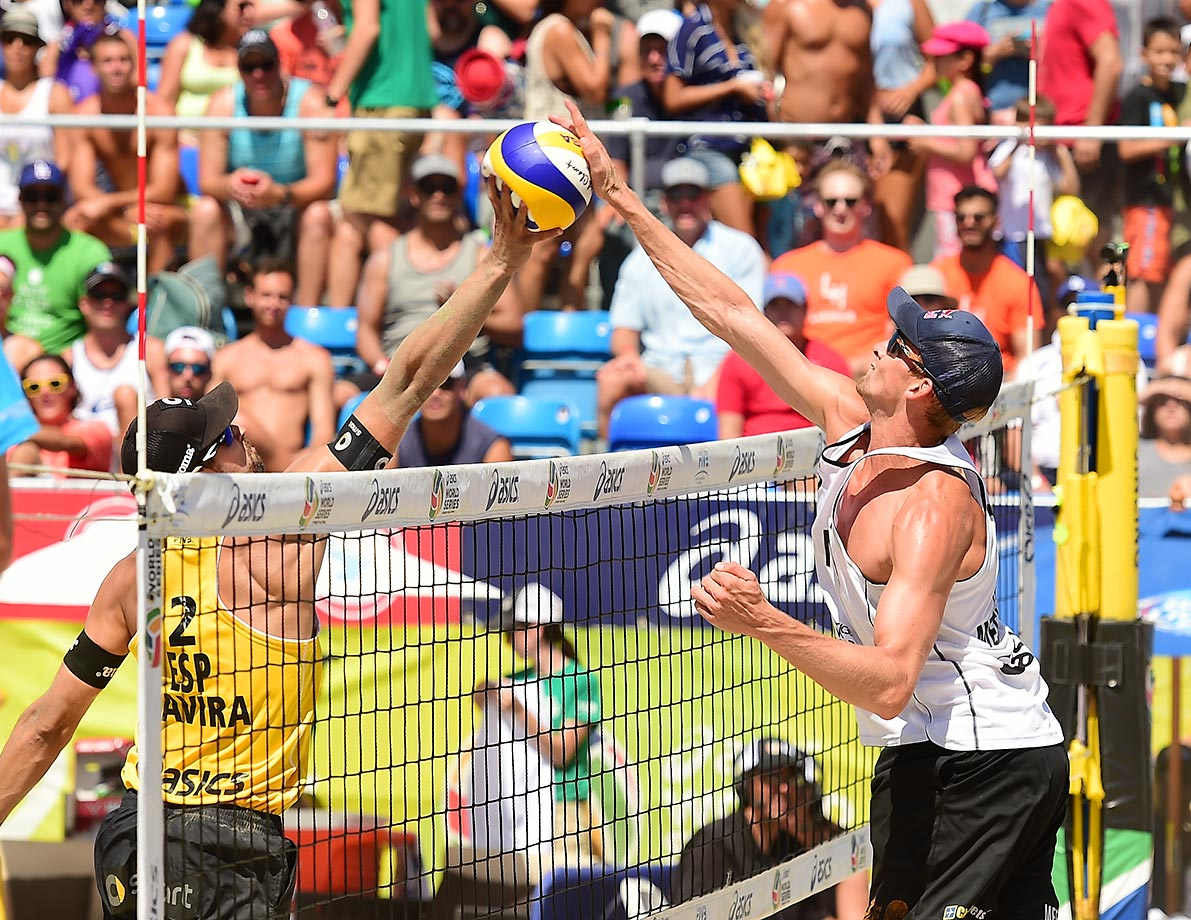 Adrian Gavira of Spain (left) and Alexander Brouwer of the Netherlands joust at the net during the bronze medal match.