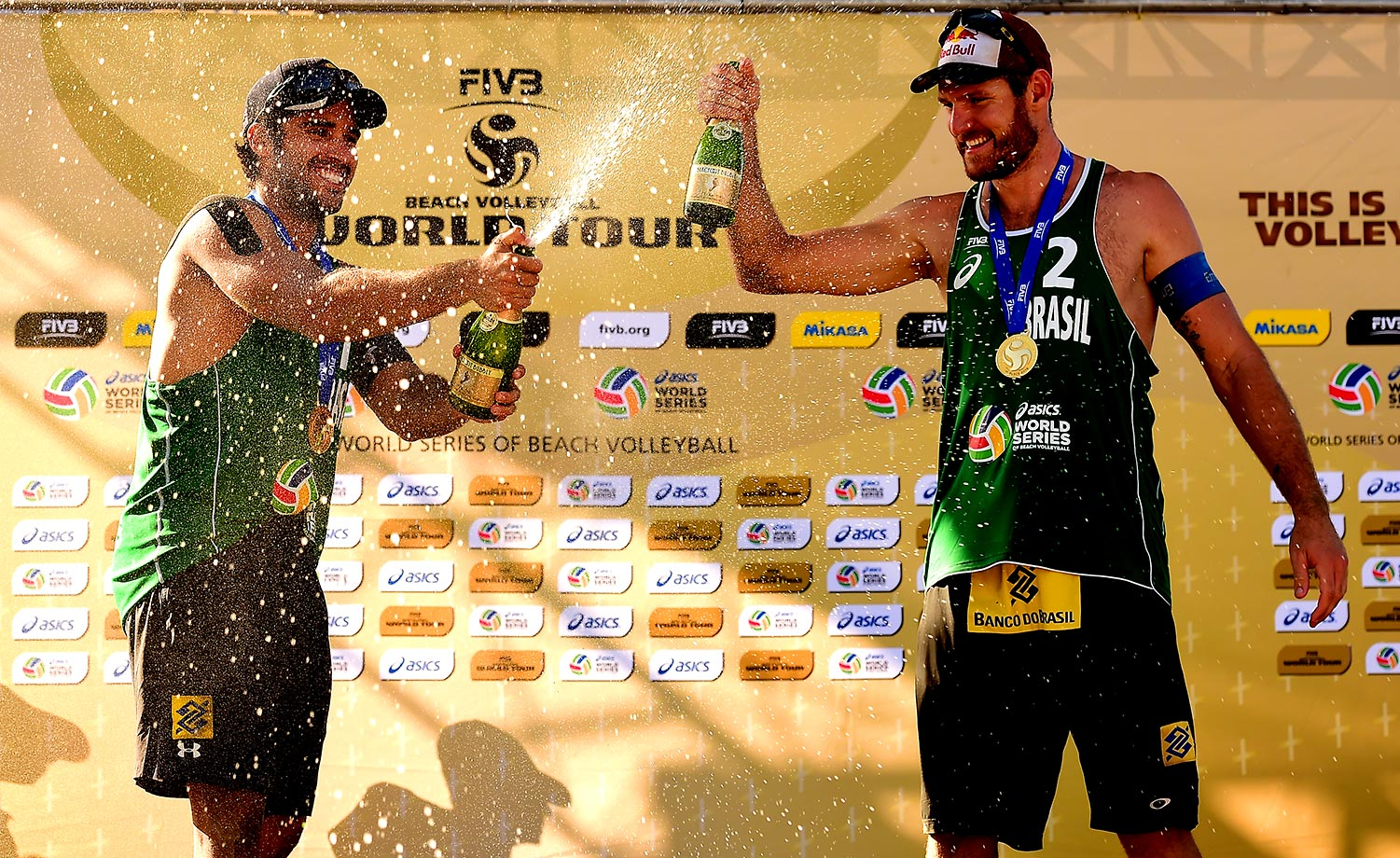 Gavin (left) and Cerutti celebrate their gold.... fourth in a row on the FIVB Tour!