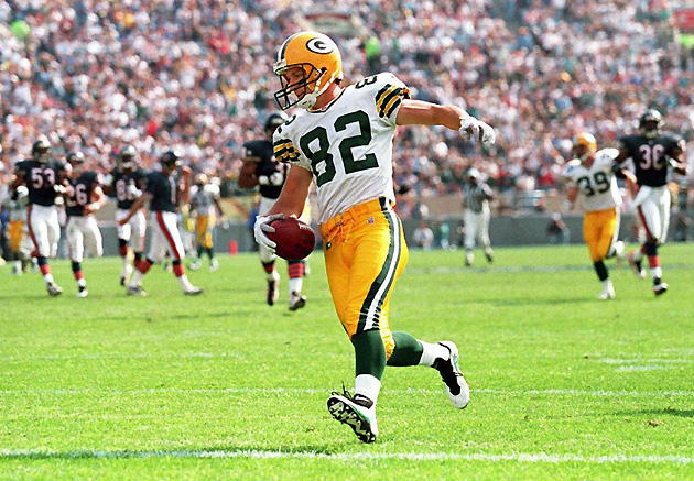 Green Bay Packers wide receiver Don Beebe steps into the end zone with the Chicago Bears in his wake after a 90-yard kickoff return for a third quarter touchdown at Soldier Field in Chicago.