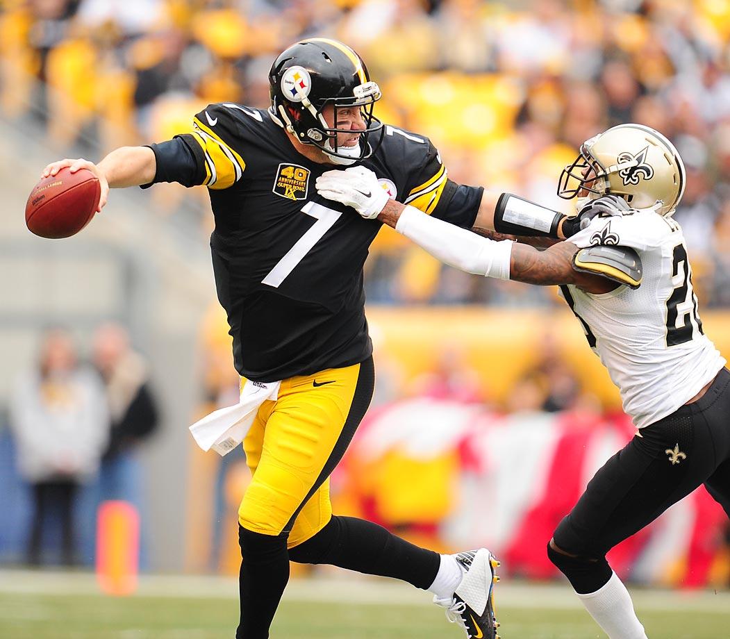 Steelers quarterback Ben Roethlisberger tries to get away from the Saints' Keenan Lewis.