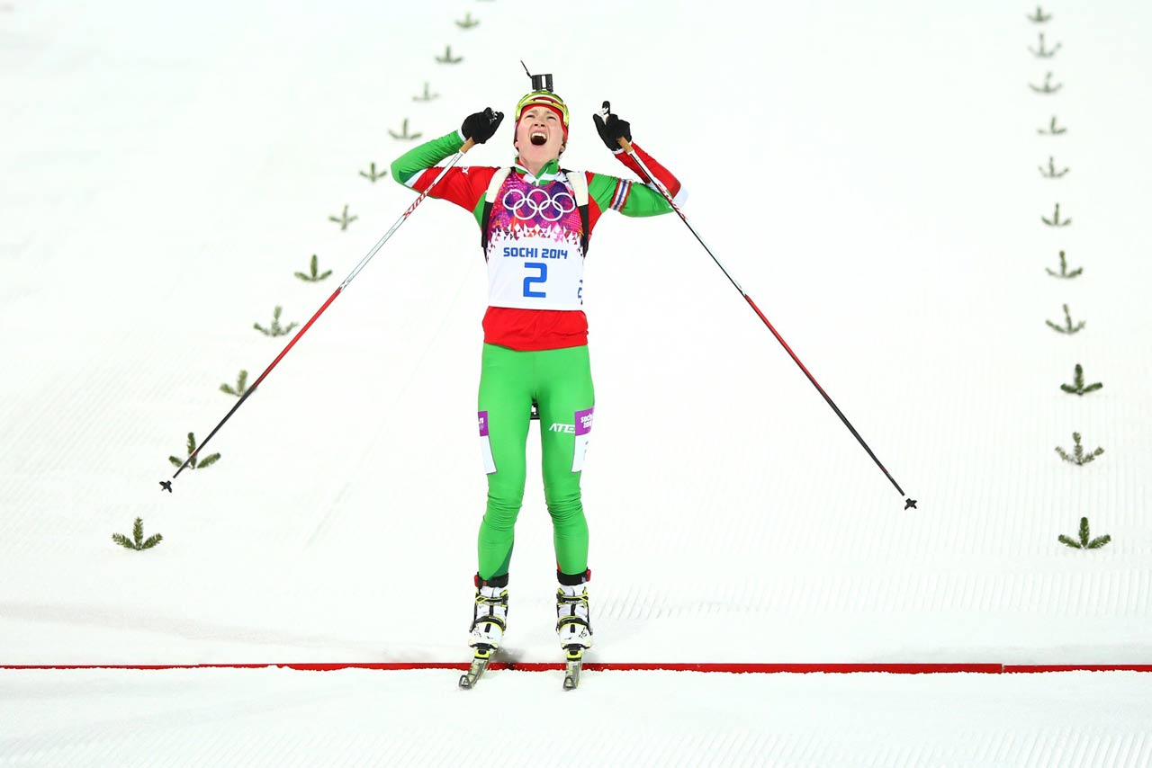 Darya Domracheva of Belarus eased to her third victory at the Sochi Games by winning the 12.5-kilometer mass start race, completing an unprecedented haul of three gold medals in women's biathlon at one Olympics. (AP)