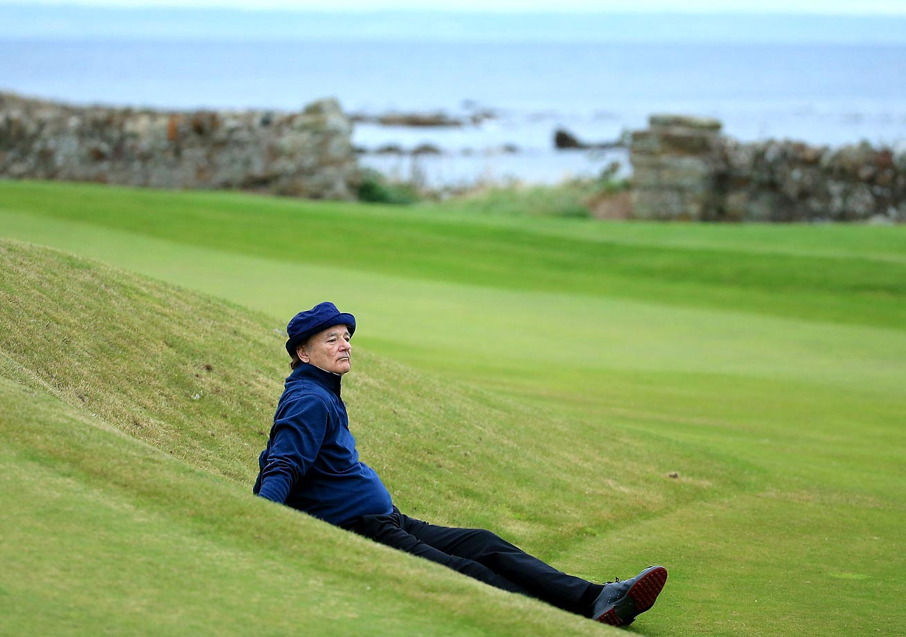 Actor Bill Murray rests on the 12th fairway during the 2014 Alfred Dunhill Links Championship at Kingsbarns, Scotland.