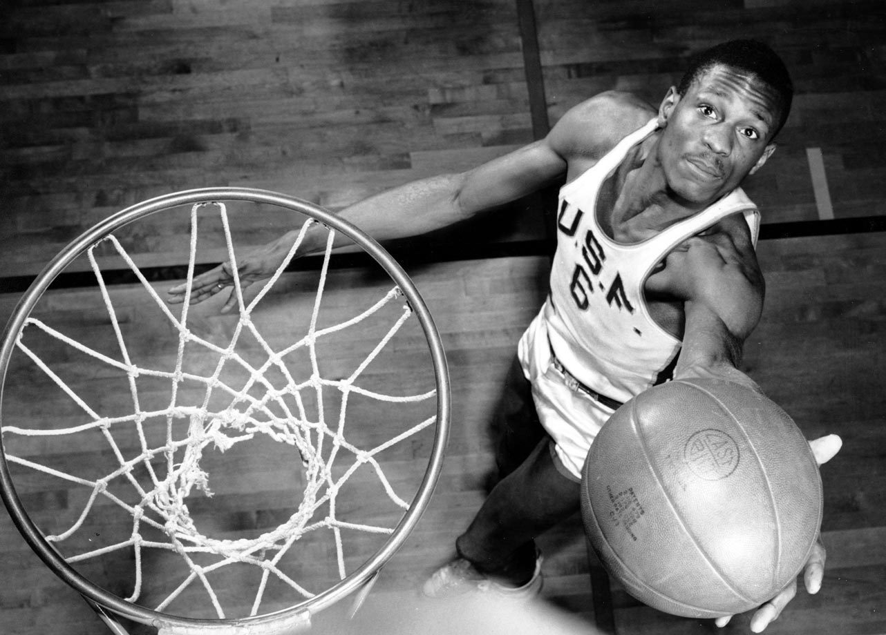 He was so dominant as a sophomore that the rules committee widened the lane from six to 12 feet to limit him. No matter. During his last two seasons at San Francisco, Russell led the Dons to a 57-1 record with back-to-back national titles and an NCAA record 60-game winning streak. Russell was at his best during the 1956 season, when he averaged more than 20 points and 20 rebounds per game. He ended the season by grabbing 27 rebounds in the 1956 NCAA final against Iowa.