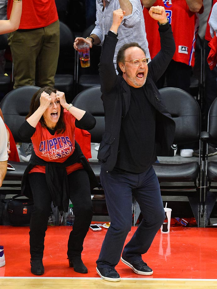 Billy Crystal and his wife, Janice, act a little crazy during a game between the Spurs and Clippers.