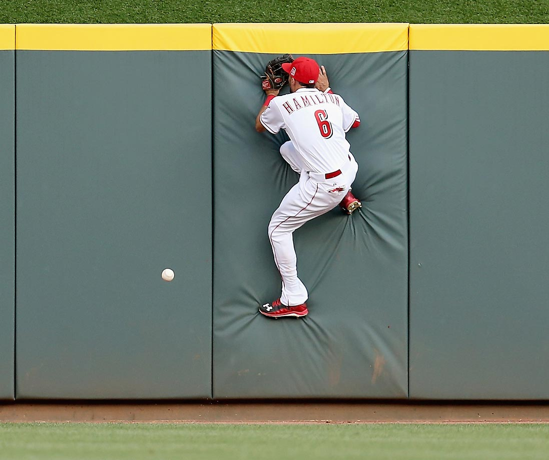 Billy Hamilton of the Cincinnati Reds can't catch this ball hit by Randal Grichuk of the St. Louis Cardinals.