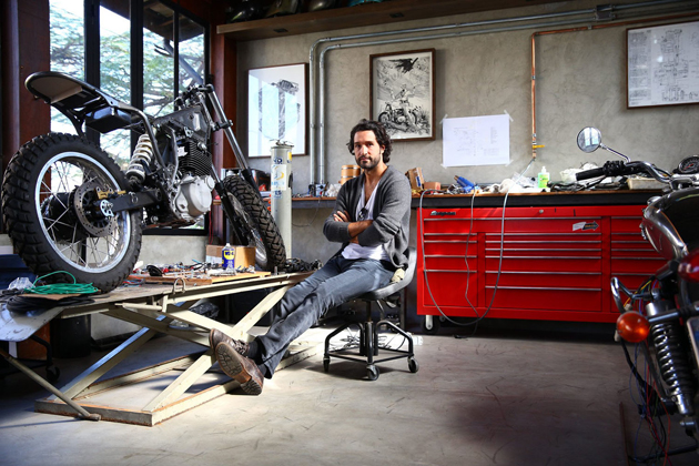 Fabio Diniz poses inside his custom motorcycle shop, which sits above his bar, Rock N Cycles, in the Vila Madalena area.
