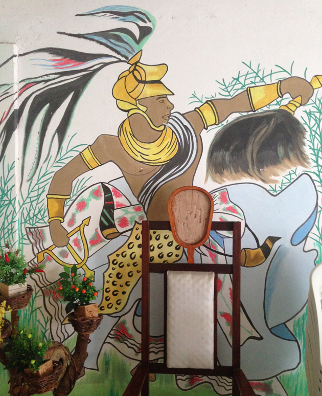 Greg Bishop's primary diety, Oxossi, painted on the wall of Gilson Ferreira dos Santos' home. Oxossi is the only Orixa that has not known death. Oxossi also brings prosperity, richness, health, power and harmony, among other things.