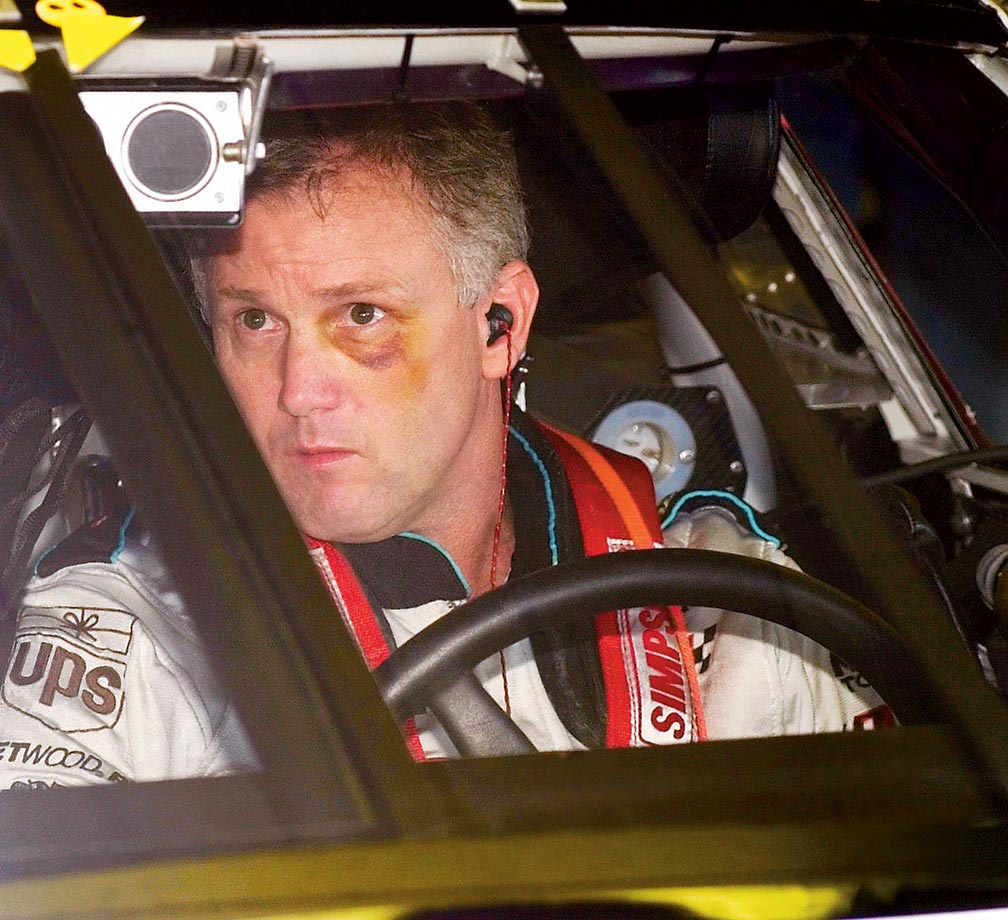 NASCAR driver Ricky Rudd sports a black eye (suffered previous race during a fight with a crewman) during practice for the 2002 New Hampshire 300.