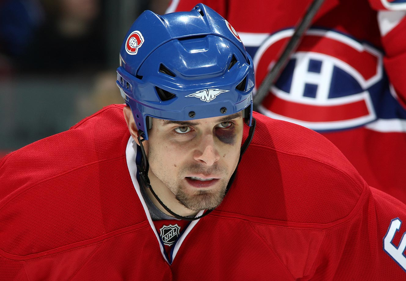 Tom Kostopoulos of the Montreal Canadiens prepares for a faceoff against the Ottawa Senators in 2008.