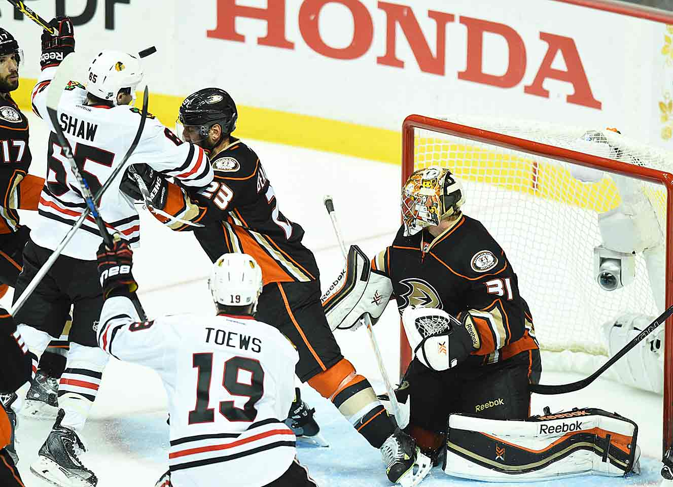 "The Hawks take Game 2 of the West finals against the Ducks, 3-2, in a 3-OT classic. Seemingly ended in the second OT by Andrew Shaw's ""header goal"" (later disallowed), the victory is finally secured by Marcus Kruger. Duncan Keith leads the way among a quartet of workhorse defensemen (including Seabrook, Oduya, Hjalmarsson), making up for Rozsival's absence with a staggering 49:51 of ice time. It's the second time in 12 playoffs games that Keith passes the 45-minute mark."
