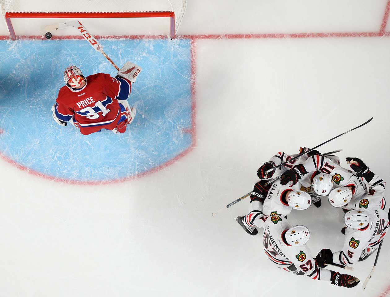After a two-day stint in fifth place in the Central (and 10th in the West), the Blackhawks rout the Canadiens by ringing up five goals on 32 shots against Vezina Trophy candidate Carey Price. Chicago will never go as low in the standings again during the season.