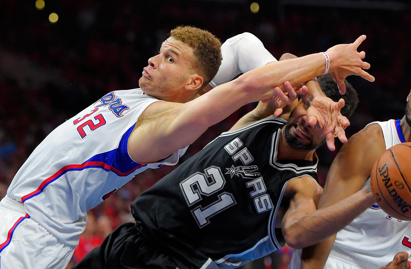 Blake Griffin of the Clippers and Tim Duncan of the Spurs battle for a rebound during Game 7 in a first-round playoff series.