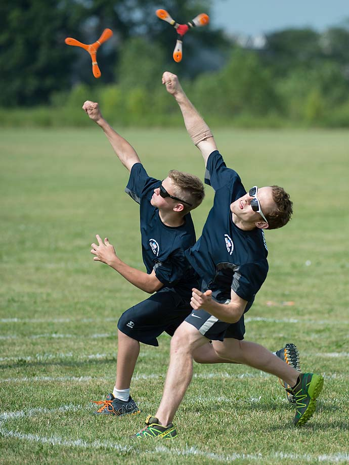 Logan Broadbent and 13-year-old Eli Gepfert sync their styles during the accuracy competition. The younger athletes learn continually from the more experienced, and in this case, world-class boomerang throwers.