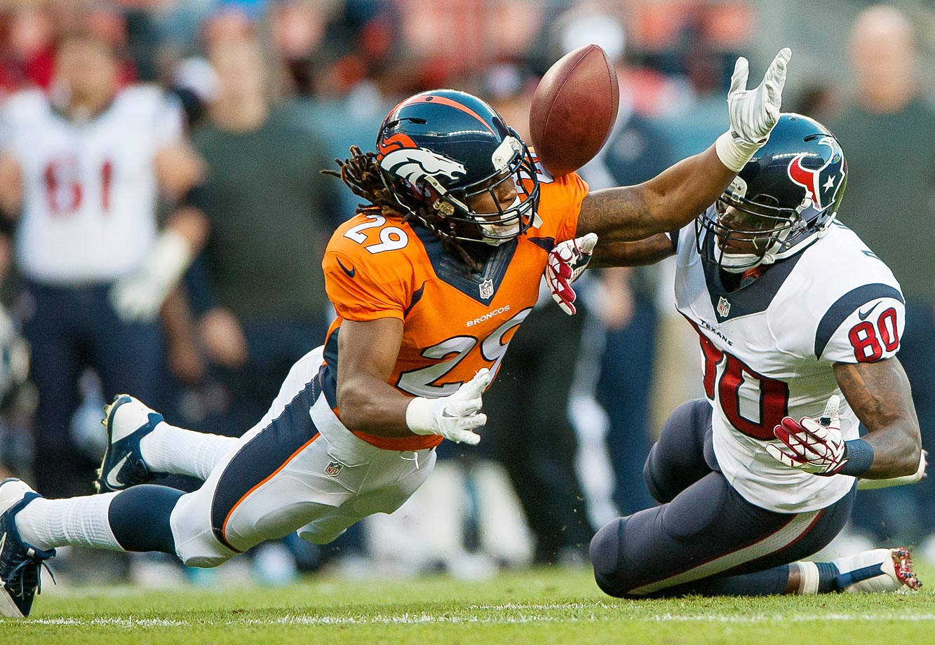 Cornerback Bradley Roby of the Broncos breaks up a pass intended for Texans wide receiver Andre Johnson on August 23.  Houston won the game, 18-17.