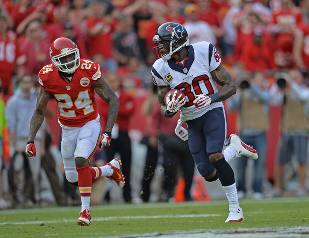Wide receiver Andre Johnson rushes up field while defensive back Brandon Flowers trails behind him looking for a tackle.