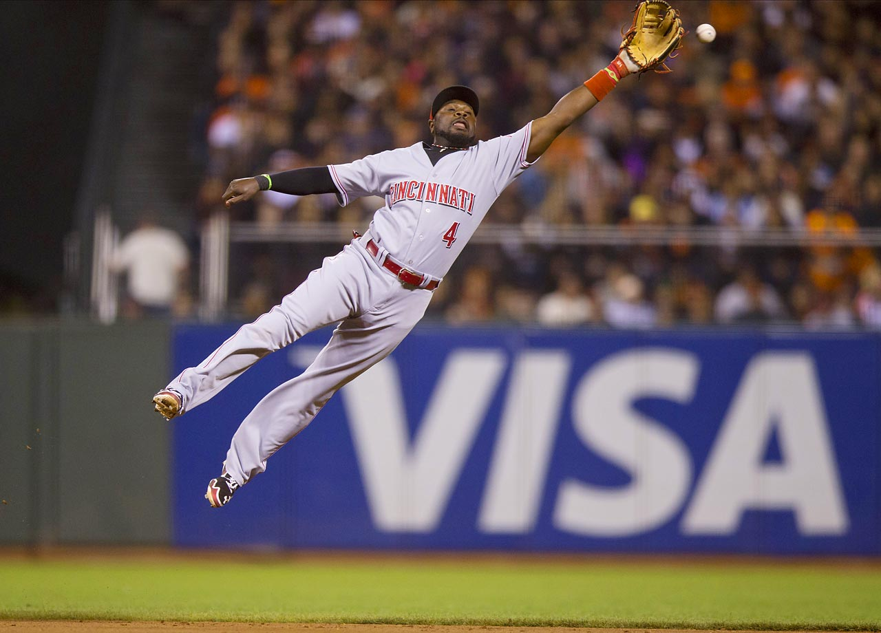Brandon Phillips of the Cincinnati Reds is unable to catch a line drive off the bat of the San Francisco Giants' Tyler Colvin (not pictured) during the eighth inning at AT&T Park in San Francisco.