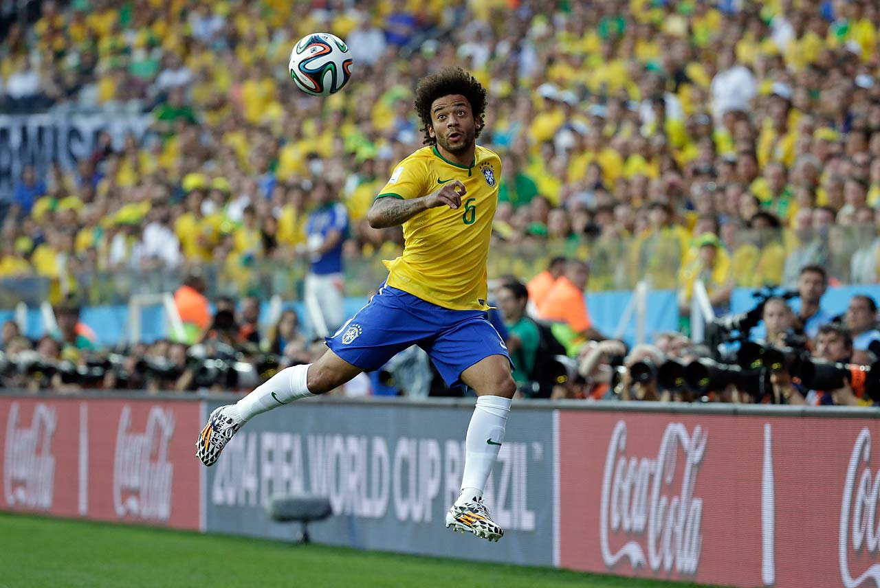 Brazil's Marcelo eyes the ball during the group A World Cup soccer match between Brazil and Croatia.